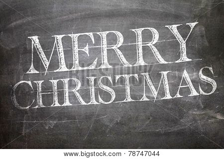 Merry Christmas written on blackboard