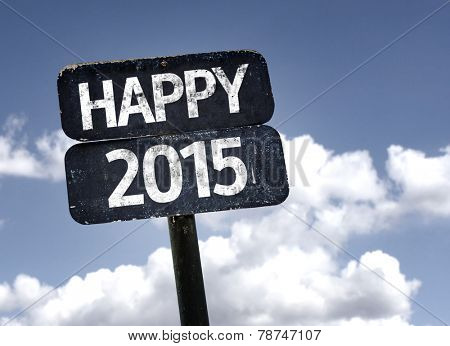Happy 2015 sign with clouds and sky background
