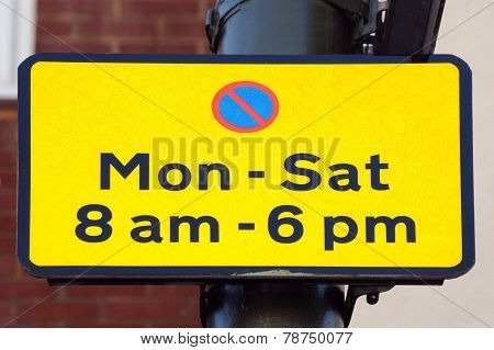 Yellow parking restriction sign.
