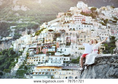 Young Bride And Groom Relaxing And Smiling After Wedding In Positano, Italy