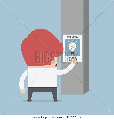 Businessman Standing In Front Of Missing Idea Poster