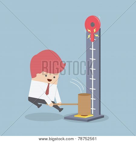 Businessman At A Carnival Hitting A Strength Tester With A Hammer