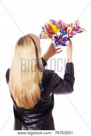 Woman Holds Gift High In Her Hands