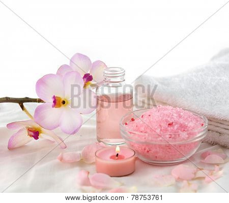 Beautiful spa setting with towel with  branch orchid