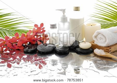 Spa Background with palm and wet stones with pink orchid ,candle,towel ,wet,oil