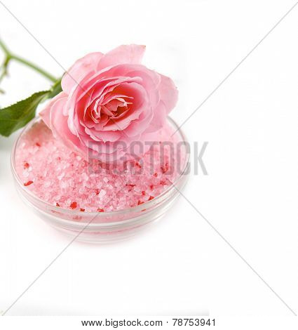 rose with salt in bowl on white background