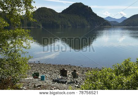 Campers At Kennedy Lake. Vancouver. British Columbia. Canada