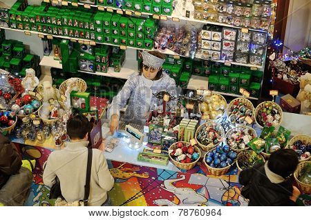 Buyers And Seller In Christmas Toys Department