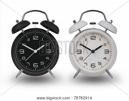 Two Alarm Clocks With The Hands At 10 And 2
