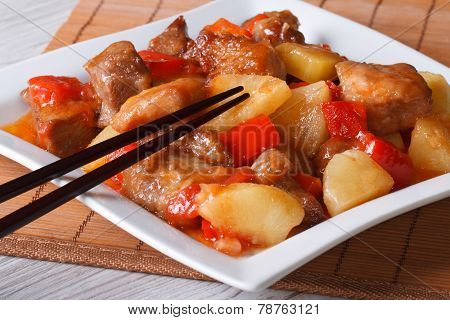 Pork Meat With Pineapple And Vegetables In Sweet And Sour Sauce