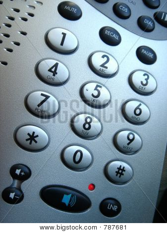 Telephone keypad with extra buttons