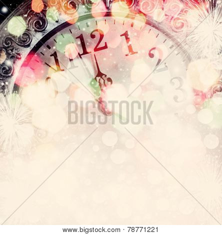 New Year's at midnight - clock on bokeh background