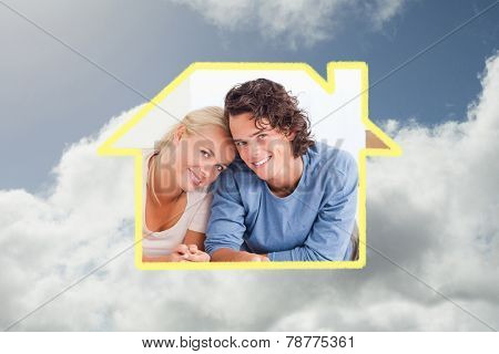 Couple organizing their future home against bright blue sky with clouds