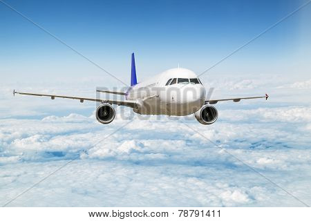 A Passenger Plane Flying Above The Clouds In The Sky