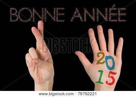 Hands against glittering bonne annee