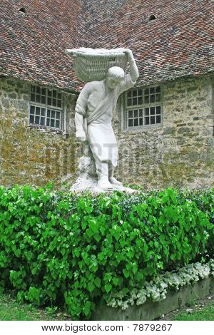 Statue Of A Man Carrying Wine Crop, Burgondy, France