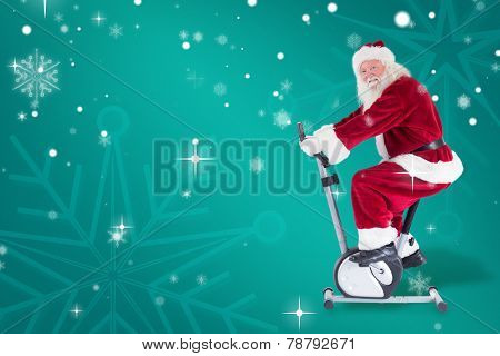 Santa uses a home trainer against green snowflake background