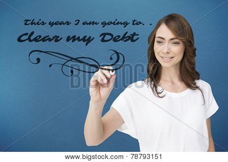 Smiling businesswoman holding marker against blue background with vignette