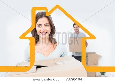Pretty woman holding boxes in her new house against house outline