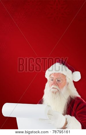 Santa claus checking his list against red background