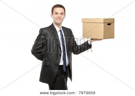 Businessman holding a paper box