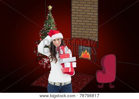 Stressed brunnette in santa hat holding gifts against red background with vignette