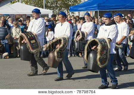 Young men carry traditional cow bells, Affoltern im Emmental, Switzerland.