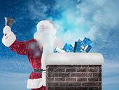 picture of blue-bell  - Santa Claus rings his bell against blue sky - JPG