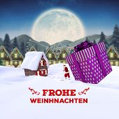 stock photo of quaint  - frohe weinhnachten against quaint town with bright moon - JPG