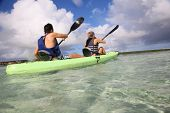 pic of west indies  - Couple canoeing in lagoon of West French indies - JPG