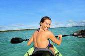 picture of west indies  - Back view of beautiful woman paddling in canoe - JPG