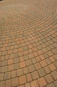 stock photo of paving stone  - Circular pattern of brick paving stones - JPG
