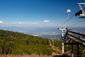image of ropeway  - Chair ropeway in mountains in early autumn