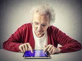 image of grandma  - A smart grandma using a tablet  - JPG