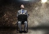 image of halo  - Young businessman with halo above head sitting on chair - JPG