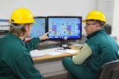 stock photo of industrial safety  - Industrial workers with helmets - JPG