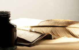 pic of inkpot  - Old book with feather and inkpot in closeup - JPG