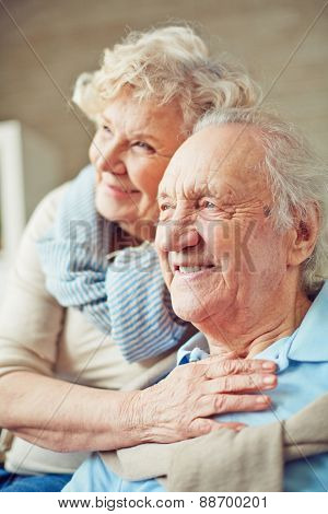 Elderly woman embracing her husband