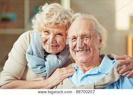 Happy seniors looking at camera