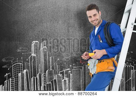 Happy construction worker leaning on ladder against hand drawn city plan