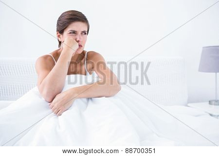 Thoughtful furious woman at home in the bedroom