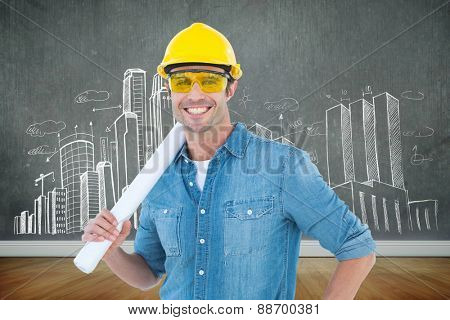 Architect holding rolled blueprint against room with wooden floor