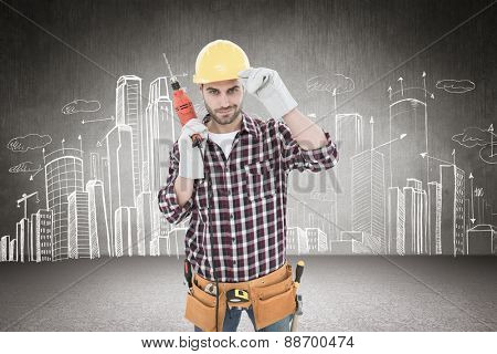 Confident handyman holding drill machine against hand drawn city plan
