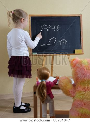 little girl playing in the school