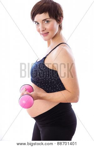 Pregnant woman keeping in shape on white background