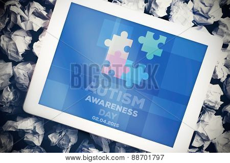 Autism awareness day against tablet pc with blue screen