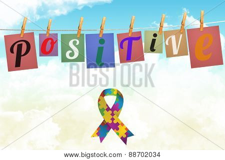Autism awareness ribbon against digitally generated grey background