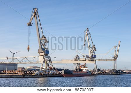 Cranes At The Industrial Port