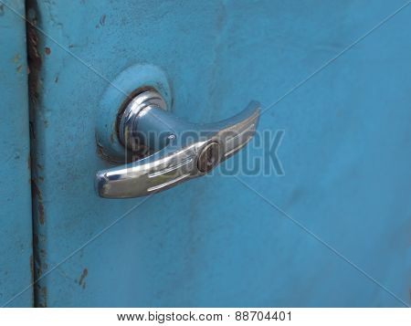 The Handle On The Door Of The Old Machine.