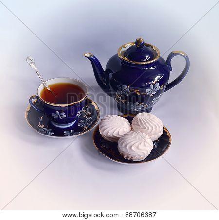 Tea drinking with marshmallows.